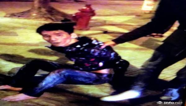 Đối tượng hành hung bị người dân bắt tại hiện trường.
